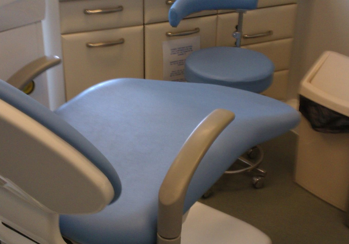 Blue surgery chair with brand new reupholstered ambla vinyl textile